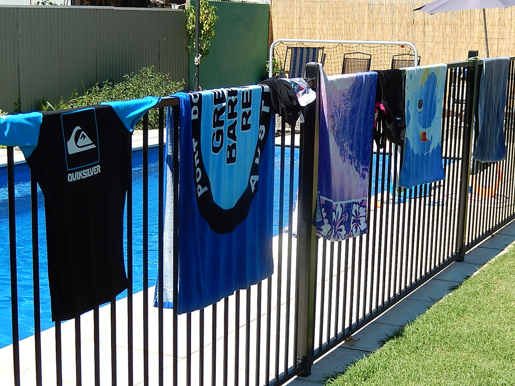 Pool fence with towels on it in Springfield Lakes